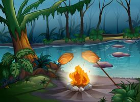 Uma fogueira em uma selva vetor