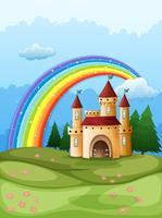 Um castelo no topo da colina com um arco-íris vetor