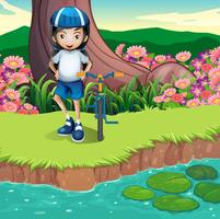 Uma menina e sua bicicleta na beira do rio