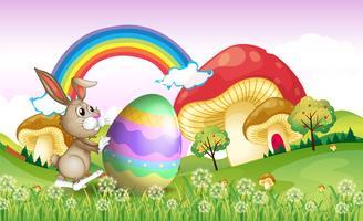 Um coelho empurrando um ovo de páscoa vetor