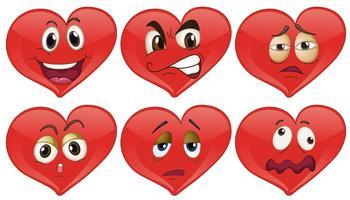 Corações vermelhos com expressões faciais vetor