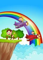 Macacos brincalhões no penhasco com um arco-íris vetor