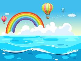 Oceano e arco-íris vetor