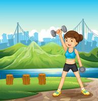 Uma senhora que exercita perto do rio