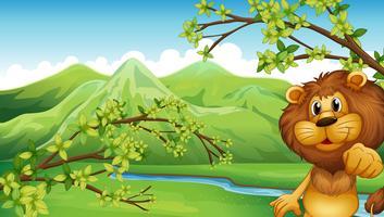 Um leão em um cenário de montanha vetor