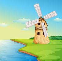Um moinho de vento ao longo do rio