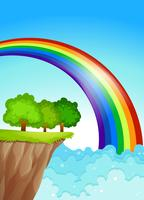 Um lindo arco-íris no céu vetor