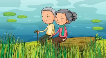 Dois idosos sentados perto do lago