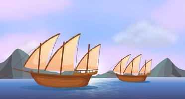Dois navios de madeira no oceano vetor