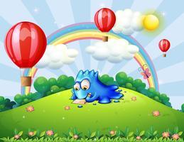 Um monstro escrevendo no topo da colina com balões flutuantes vetor