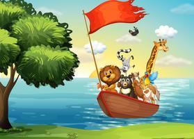 Animais em barco vetor