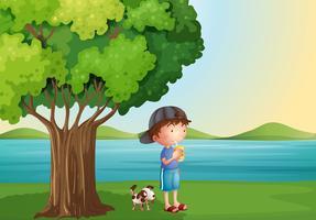 Um, menino jovem, e, seu, animal estimação, sob, a, árvore vetor