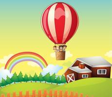 Crianças em um balão de ar e uma casa