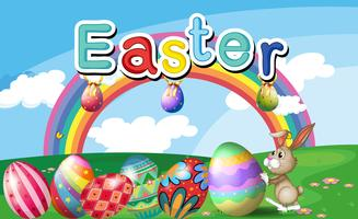 Um morro com ovos de páscoa, um arco-íris e um coelho vetor