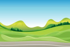 Uma estrada e uma bela paisagem vetor