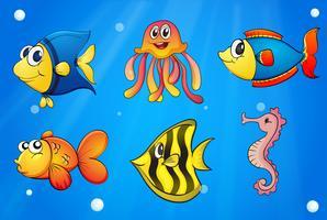 Um mar com criaturas coloridas vetor