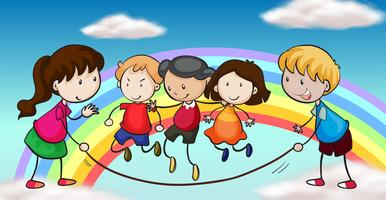 Cinco crianças brincando na frente de um arco-íris