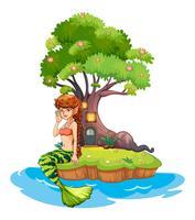 Uma linda sereia perto da casa da árvore vetor