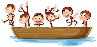 Macacos e barco vetor
