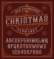 Alfabeto de Natal vintage sobre o fundo escuro.