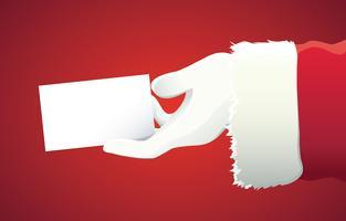 Papai Noel mão apresentando seu texto de Natal ou produto sobre fundo vermelho, com espaço de cópia