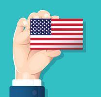 mão segurando o cartão de bandeira EUA com fundo azul vetor