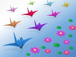 Pássaros de origami voando sobre a água e o lótus