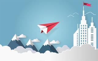 Conceito da liderança, voo vermelho do avião no céu com a nuvem sobre a montanha e construção arquitetónica com uma bandeira na parte superior.