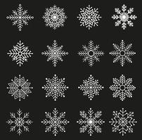 Conjunto de flocos de neve brancos vetor