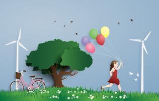 a garota correndo no campo com balão. Estilo de arte de papel. vetor