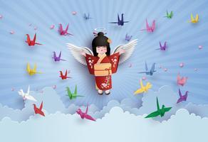 Meninas japonesas que vestem o pássaro nacional do vestido e do origâmi que voam no céu com clound.