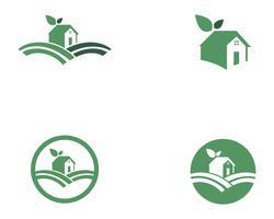 Logotipo da natureza verde folha em casa vetor