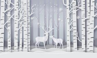 Veados na floresta com neve.