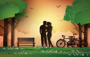silhueta de casal em pé no jardim