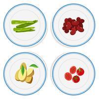 Vegetais diferentes em placas redondas vetor