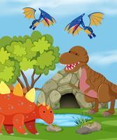 Grupo de dinossauro na natureza vetor