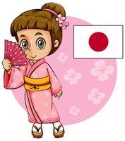 Menina japonesa no quimono rosa e bandeira do Japão