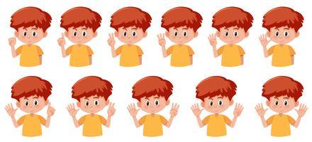Conjunto de menino com gesto de número de mão vetor