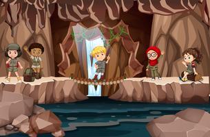 Crianças multiculturais na caverna vetor
