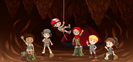 Estudante na caverna vetor