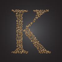 Letra decorativa dourada floral K