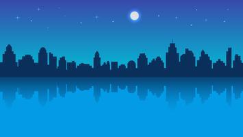 Cidade da noite com reflexão e céu estrelado