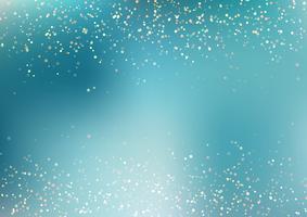 O brilho dourado de queda abstrato ilumina a textura no fundo azul de turquesa com iluminação. Pó de ouro mágico e brilho. Fundo festivo de Natal.