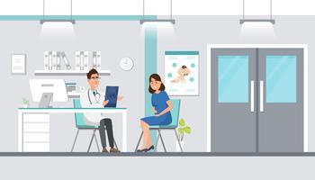 Doutor que mostra a folha do ultrassom à mulher gravida no hospital.