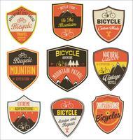 Conjunto de emblemas vintage retrô de bicicleta e rótulos vetor