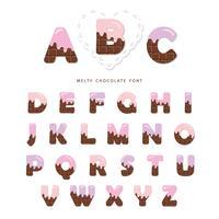 Alfabeto com creme rosa derretido no chocolate.