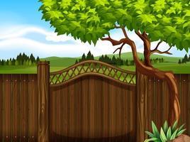 Cerca de madeira no jardim vetor