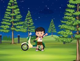 Menino e moto no parque à noite vetor