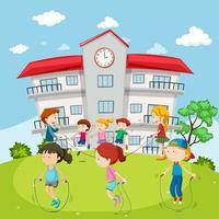 Crianças pulando corda na frente da escola