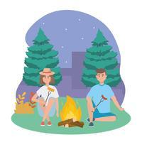 Homem e mulher com fogueira à noite vetor
